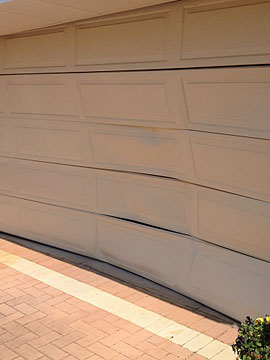 Damaged sectional door panels